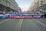 Колонна участников шествия марширует по Тверской улице