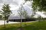 По задумке Рема Колхаса, «приподнятый на два метра над землей ультрасовременный фасад из полупрозрачного двухслойного поликарбоната визуально объединит здание музея с парком»