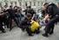 Полиция разнимает дерущихся сторонников и противников закона о запрете пропаганды гомосексуализма среди детей