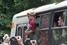 Задержанные участники акции «День поцелуев» приветствуют своих сторонников и журналистов из полицейского автобуса