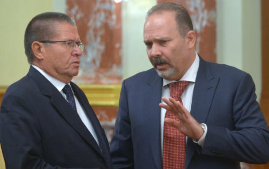 Министр экономического развития Алексей Улюкаев и глава Минстроя Михаил Мень