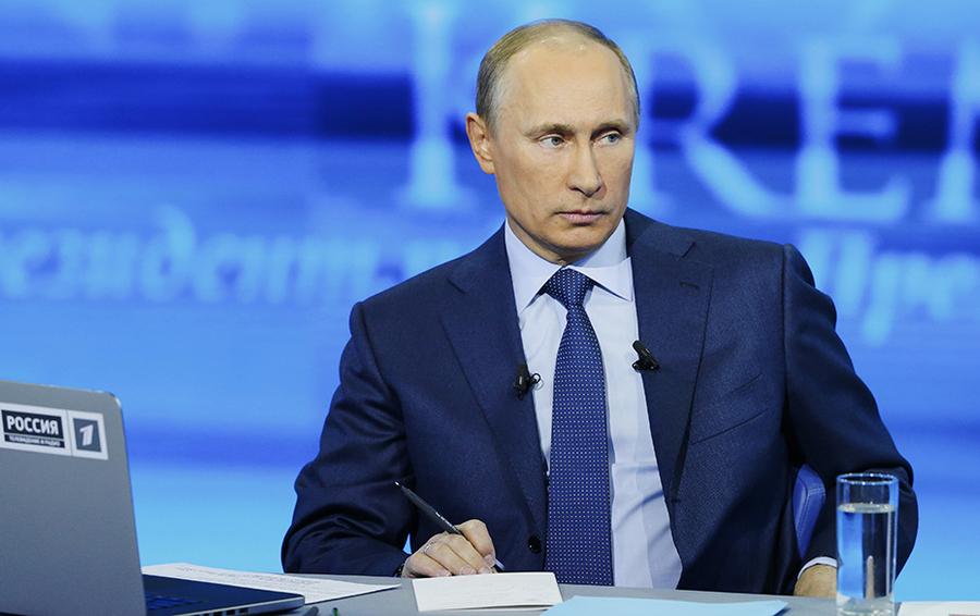 Владимир Путин во время