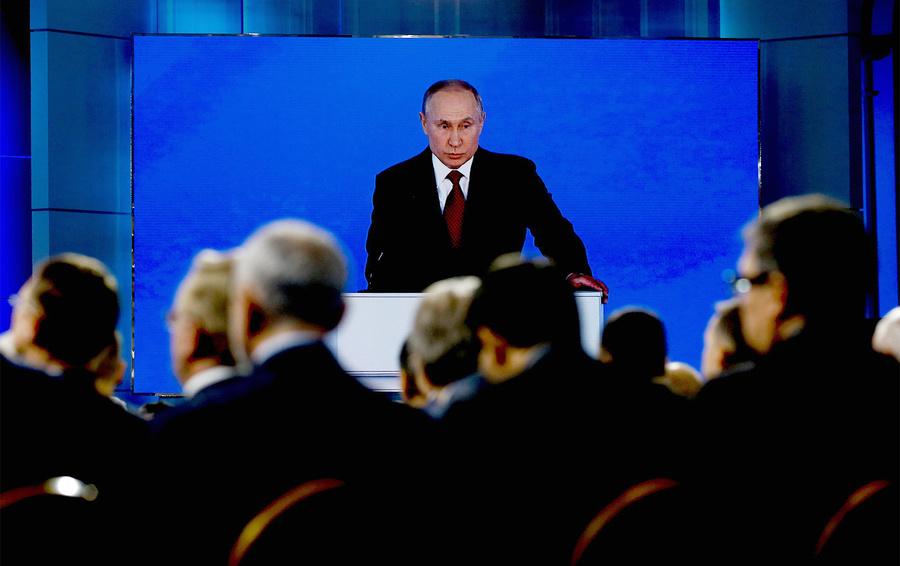 Владимир Путин во время выступления с ежегодным посланием к Федеральному Собранию.